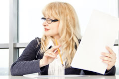Mid adult woman work with documents Royalty Free Stock Image