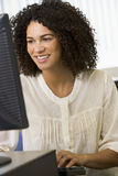 Mid adult woman working on a computer Royalty Free Stock Images