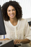 Mid adult woman working on a computer Stock Images