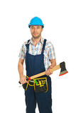 Mid adult workman holding axe Stock Photo