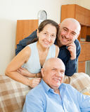 Mid-adults friends at home Stock Image