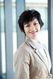Mid age businesswoman. Happy mid age businesswoman portrait in office Royalty Free Stock Photo