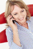 Mid age businesswoman using cellphone Stock Image