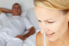 Mid age couple on bed Royalty Free Stock Images