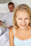 Mid age couple in bedroom Stock Photos