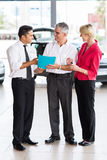Mid age couple buying new car Stock Images