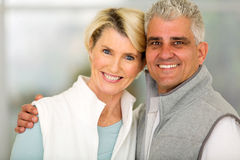 Mid age couple home Stock Photo
