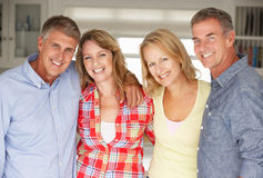Mid age couples at home relaxing Stock Photography