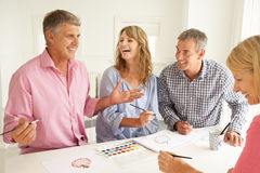 Mid age couples painting with watercolors Stock Image