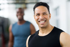 Mid age gym trainer Royalty Free Stock Photography