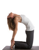 Mid-Age Healthy Looking Female Practicing Yoga Royalty Free Stock Photos