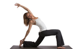 Mid-Age Healthy Looking Female Practicing Yoga Stock Images