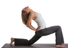 Mid-Age Healthy Looking Female Practicing Yoga Royalty Free Stock Images