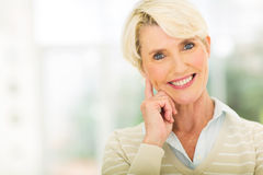 Mid age lady. Beautiful mid age lady looking at the camera royalty free stock photography