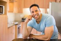 Mid age man kitchen Stock Image