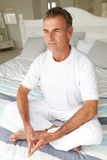 Mid age man in lotus position Stock Photos