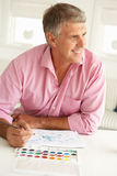 Mid age man painting Stock Image
