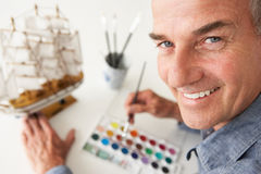 Mid age man painting model stock image