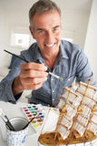 Mid age man painting model Stock Images