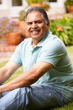 Mid age man relaxing in garden Stock Photo