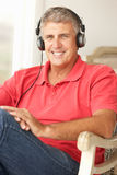 Mid age man wearing headphones royalty free stock photo