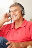 Mid age man wearing listening to music Stock Photo