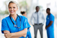 Mid age medical doctor. Confident mid age medical doctor in hospital Royalty Free Stock Photo