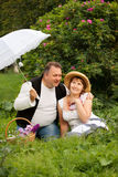 Mid age plus size couple having date in the park. Sunny day Royalty Free Stock Photography