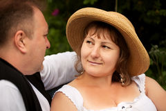 Mid age plus size couple having date in the park. Sunny day stock photos