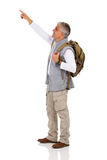 Mid age tourist pointing. Handsome mid age tourist pointing copy space on white background Stock Images