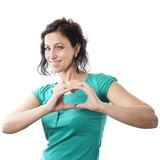 Mid age woman forming heart shape Royalty Free Stock Images