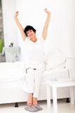 Mid age woman getting up. Beautiful mid age woman getting up in the morning stock images