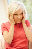 Mid age woman with headache Royalty Free Stock Image