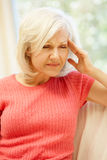 Mid age woman with headache Royalty Free Stock Photos