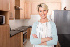 Mid age woman kitchen Stock Photos