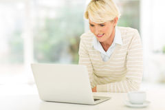 Mid age woman laptop computer Stock Photos