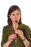 Mid-age woman playing flute. Over white background Royalty Free Stock Images