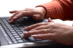 Mid age woman's hands on the laptop Stock Photo