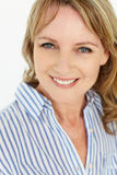 Mid age woman smiling. At camera stock photography