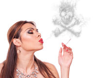 Woman blowing smoke-skull Stock Photo
