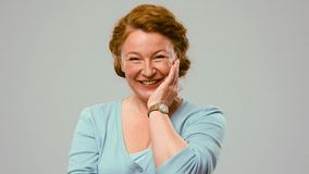 Mid aged actress showing emotions of affection. Royalty Free Stock Images