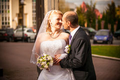 Mid-aged bride and groom standing on street Royalty Free Stock Image