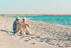 Mid aged couple on the seaside Stock Images