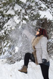 Mid aged cute woman playing with snow Royalty Free Stock Photography