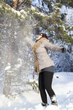 Mid aged cute woman playing with snow Royalty Free Stock Image