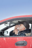 Mid aged man sneezes in a car Royalty Free Stock Images