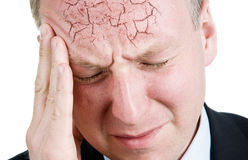 Mid aged man suffering from headache Royalty Free Stock Images