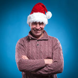 Mid aged man wearing a santa hat. Handsome mid aged man wearing a santa hat while holding his arms crossed. Looking at the camera Stock Images