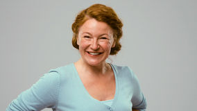 Mid aged positively smiling actress. Stock Photo