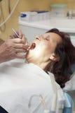 Mid aged woman at dentist Royalty Free Stock Photo